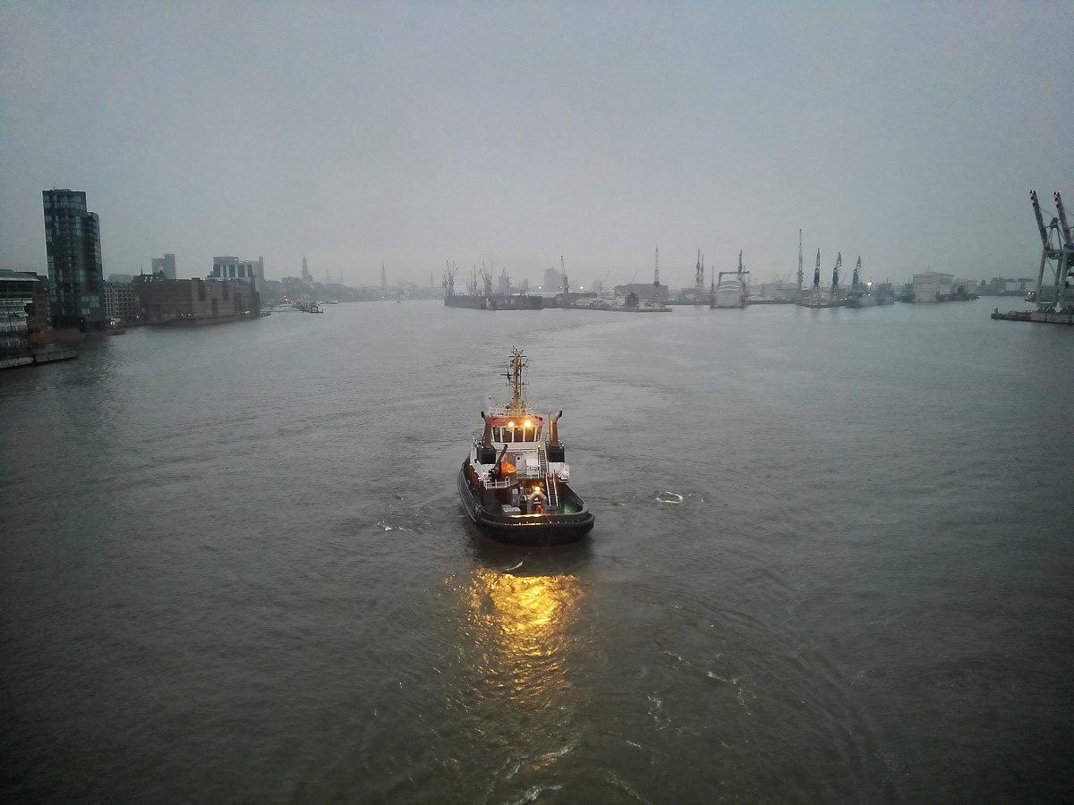 The tugboat leaves us