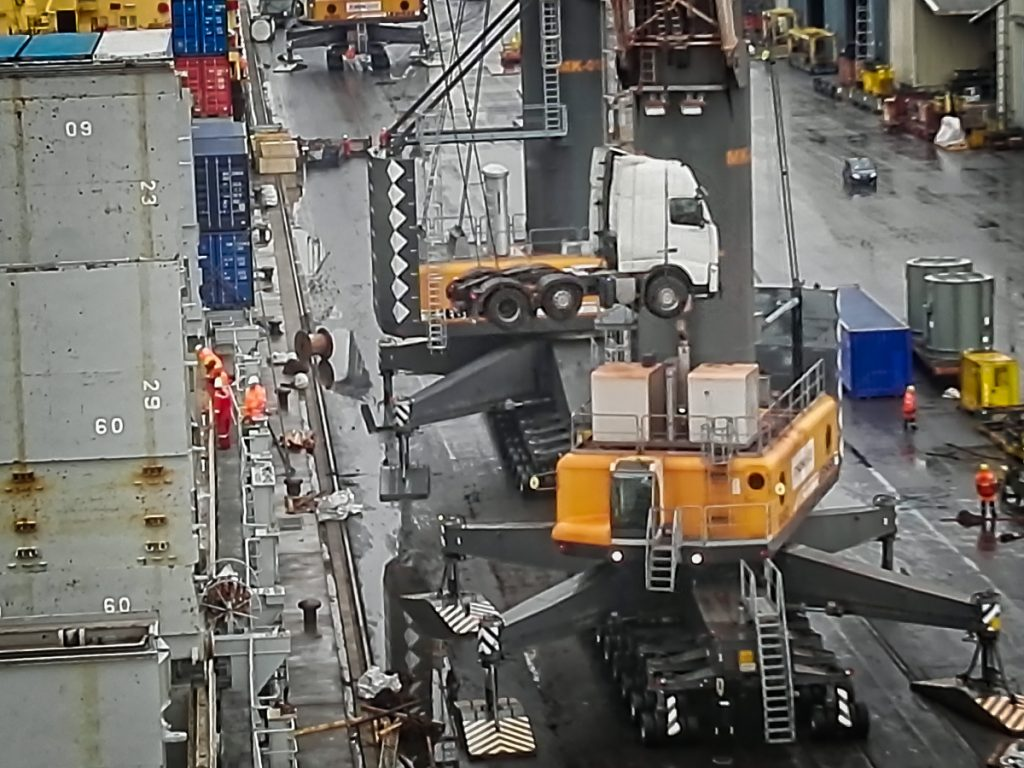 Truck is hoisted onto the ship